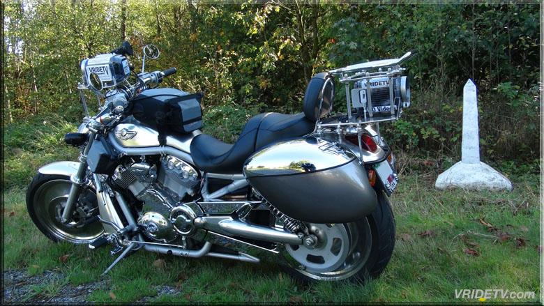 Motorcycle Canada USA border. TRUMP WALL