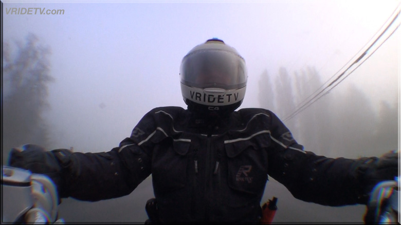 motorcycle rider in fog