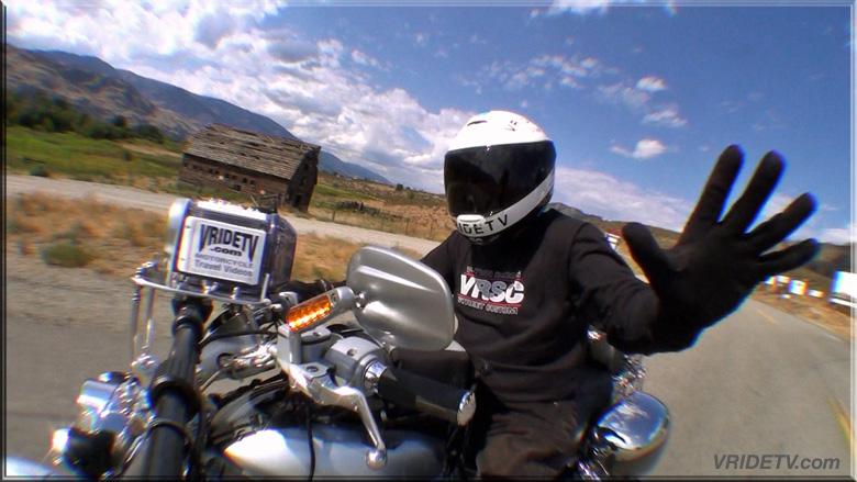 biker waving at tourists