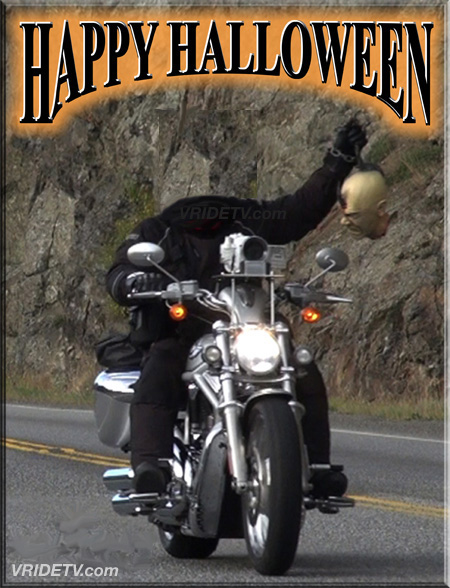 Headless biker with zombie head on a hook