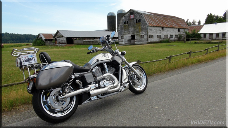 Harley Davidson motorcycle with a country farm
