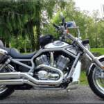 2003 Harley-Davidson Vrod equipped with: HD saddlebags, Avon tyres, Pingle steering stabilizer, PIAA led lights, Superbrace, Ortlieb cmaera bag, more parts still to be installed from Progressive Suspension & Unlimited Engineering.
